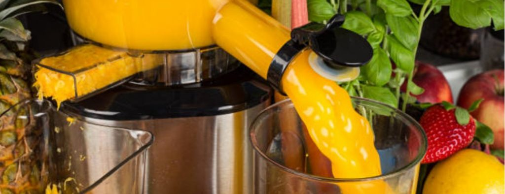 Orange juice is extracted by electric juice